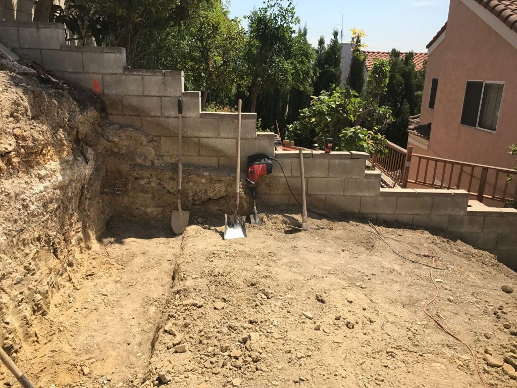 digging-wall-for-retaining-wall-structure-