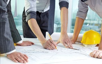 Engineering Team Going Over Blueprints