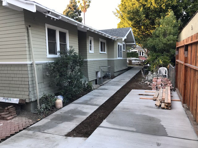 freshly-paved-concrete-walkway-