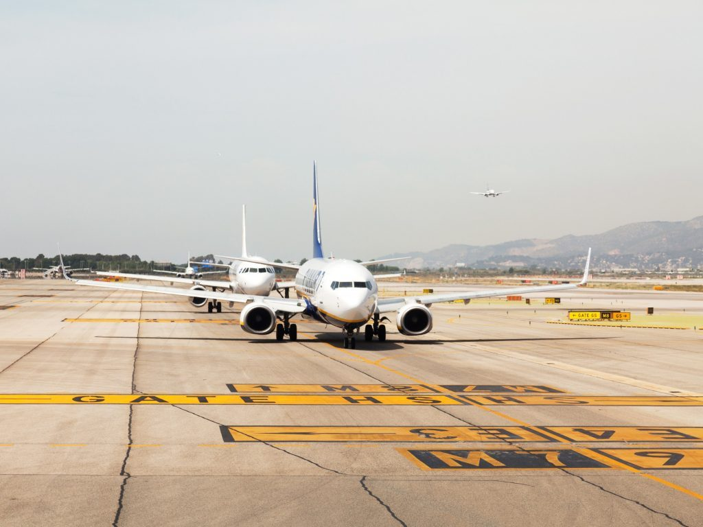 Airplane on Damaged Airport Runway or Tarmac