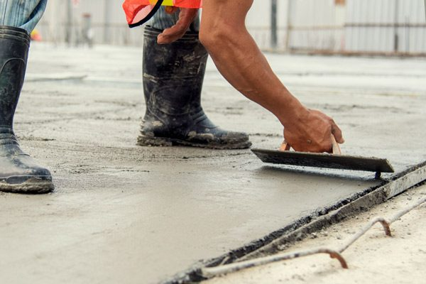 Worker Leveling Concrete