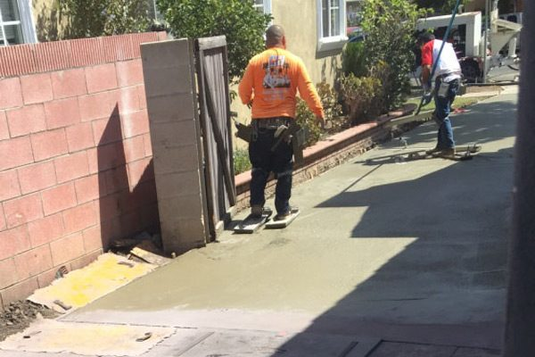 Construction Worker Smoothing Concrete
